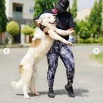 Empress Njamah Pose With Her Hefty St. Bernard Dogs In New Pictures