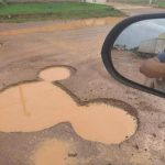 """Funny reactions as man spots """"Mickey Mouse"""" pothole in Lagos (Photos)"""